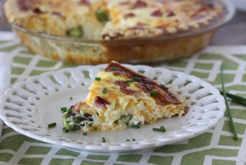 Asparagus & Ham Quiche is perfect for any meal - breakfast, brunch, lunch or dinner. This easy asparagus recipe is great to serve any time of the year, but especially in the spring when asparagus is in season.