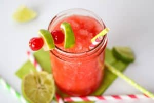 This Cherry Limeade Slush is a copycat recipe of your favorite Sonic Drive-In Drink. This drink recipe has the perfect balance of cherry and lime flavor. It is a perfect way to cool down and relax on a hot summer's day.