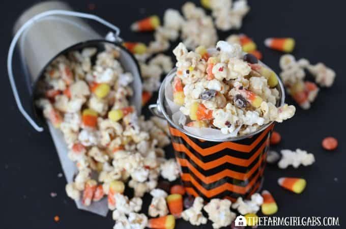 This Candy Corn Popcorn recipe is the perfect Halloween snack. | www.thefarmgirlgabs.com