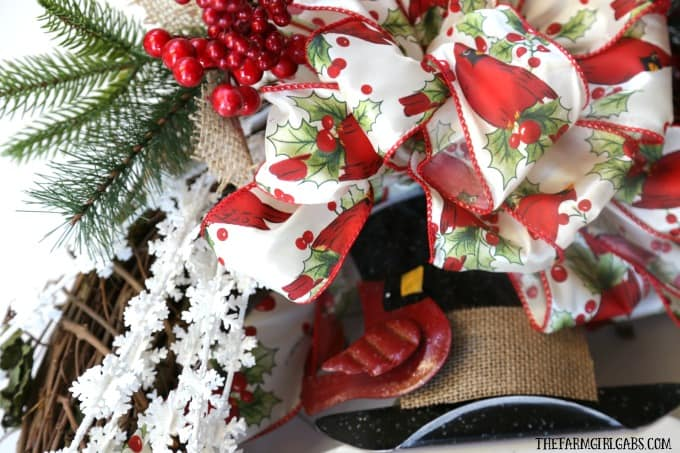 Brighten your Christmas decor with this simple DIY Jolly Snowman Christmas Wreath. This holiday craft idea is perfect hanging on a door at home.