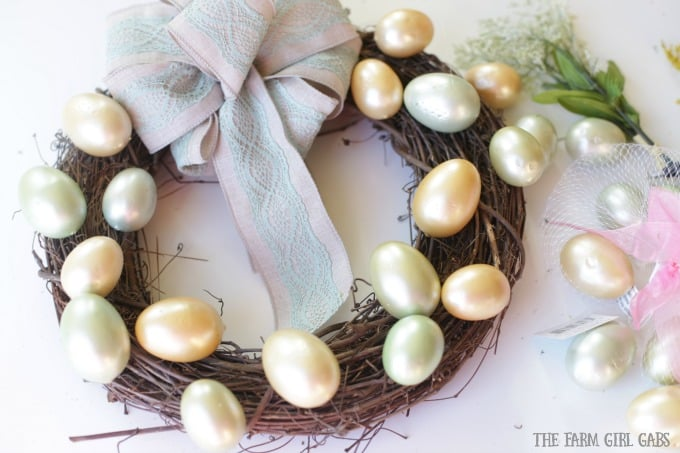 Brighten up your front door with this easy and welcoming DIY Spring Easter Egg Wreath. It's the perfect way to welcome spring.