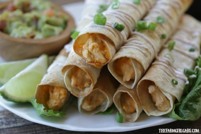Feed a crowd this Cinco de Mayo with these delicious Baked Buffalo Chicken Flautas. This easy recipe is the perfect Mexcian night meal. Ad #GoTortillaLand