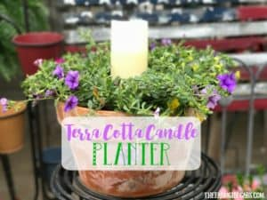 Beautify your backyard decor with this pretty Terra Cotta Candle Planter. This simple DIY candle planter will add some pretty ambiance to your patio.