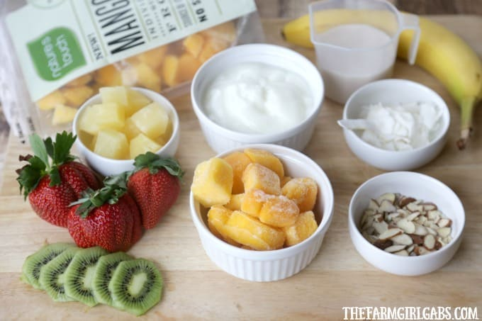 This Tropical Smoothie Bowl is a blend of mango, tropical fruit and coconut milk - it's cool, refreshing and packed with flavor and nutrients. #Ad #FlavorAdventure