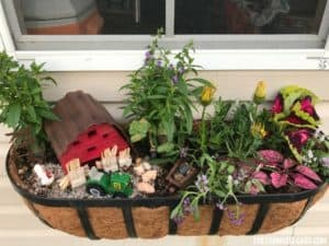 Brighten up your gardening landscape with this DIY Miniature Farm Window Box Planter idea.