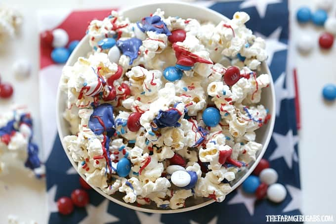 Salute the red, white and blue with this tasty Patriotic White Chocolate Popcorn.This delicious snack is perfect for your next star-spangled party.