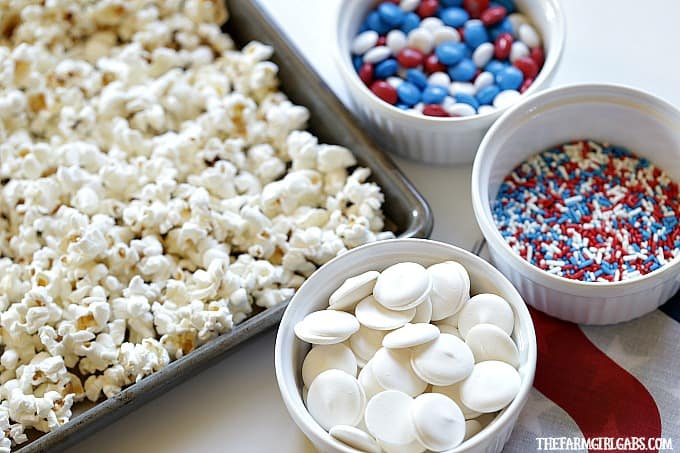 Salute the red, white and blue with this tasty Patriotic White Chocolate Popcorn. This delicious snack is perfect for your next star-spangled party.