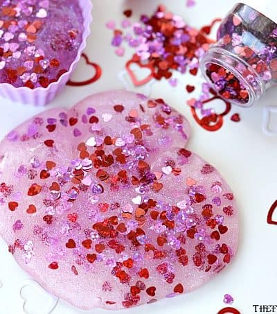 You and yourkids will LOVE making this easy DIY Valentine's Day Slime project. This fun craft makes a great party favor too!