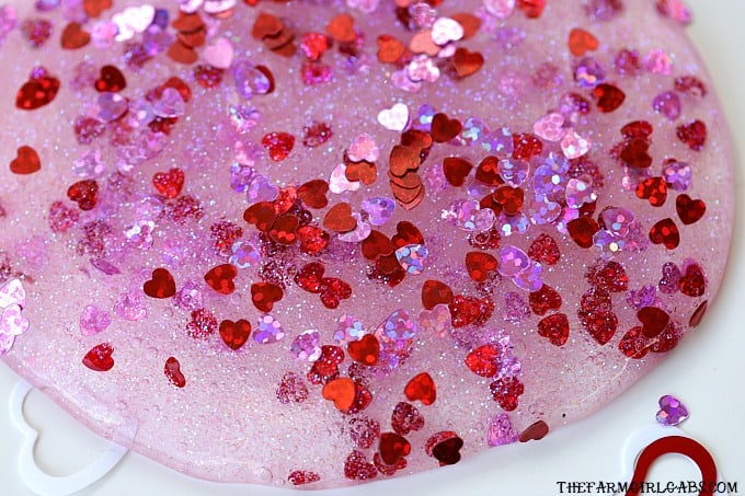 You and your kids will LOVE making this easy DIY Valentine's Day Slime project. This fun craft makes a great party favor too!