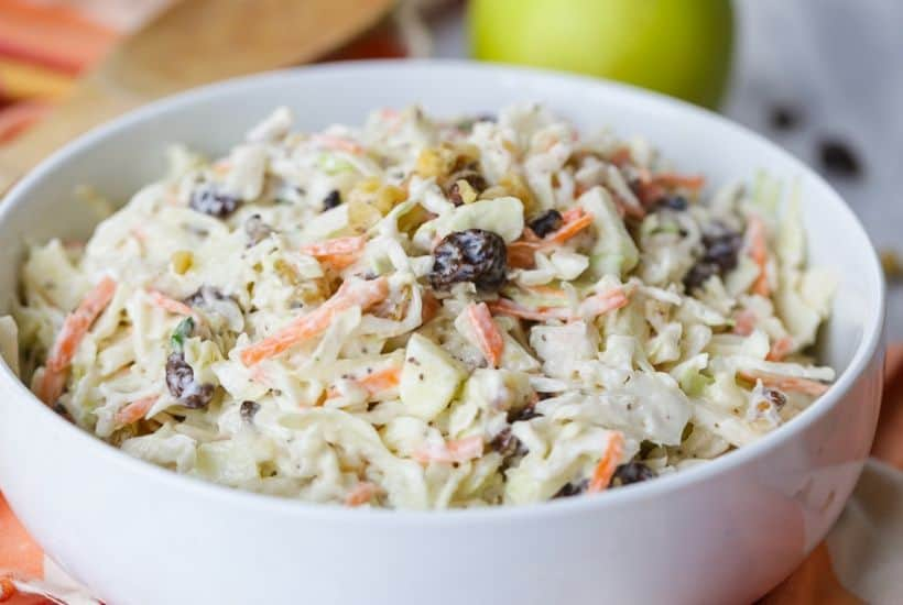 Coleslaw isn't just for picnics. Take your coleslaw to a new level with this tasty Apple Raisin Coleslaw. This southern coleslaw recipe is the perfect side dish to serve any time of year. Ready in just 10 minutes, this delicious coleslaw recipe is topped with a creamy homemade dressing. It's the perfect blend of sweet and savory. #coleslaw #easyrecipe #southerncoleslaw