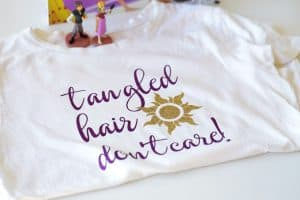 Have the Best Day Ever by creating your own DIY Rapunzel Tangled Hair Don't Care Shirt to wear. This easy tutorial is the perfect way to show your Disney Side! #Rapunzel #DisneySide #DisneyCraft #WaltDisneyWorld #DisneyShirt