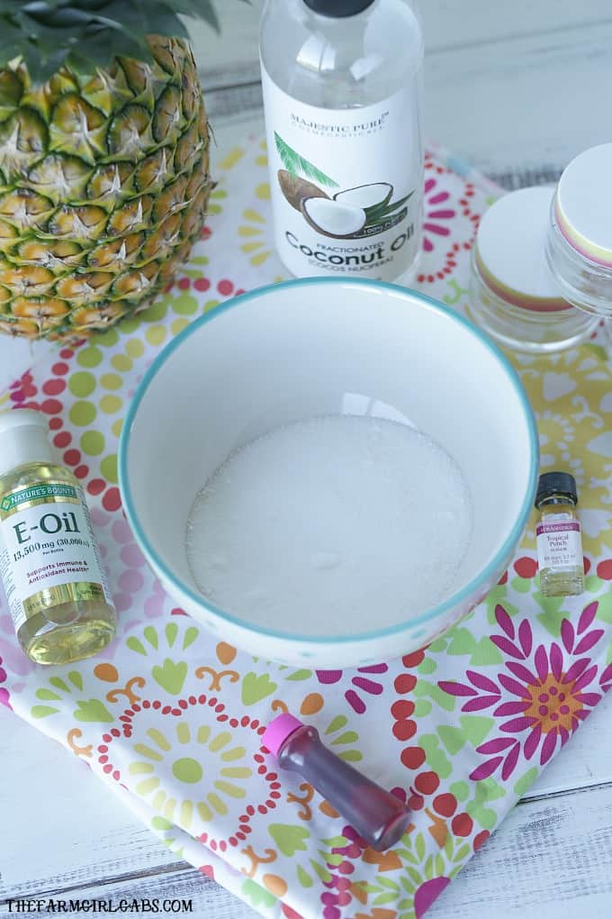 Sooth and exfoliate those chapped lips with this easy DIY Tropical Punch Lip Scrub that you can make at home. #DIY #essentialoils #scrub #lipscrub #beauty