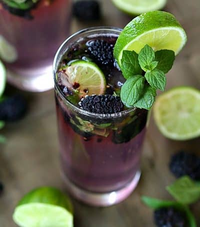 Cheers to summer, blackberry season and this refreshing Blackberry Mojito. #drinks #mojito #blackberrymojito #cocktailrecipes #drinkrecipe