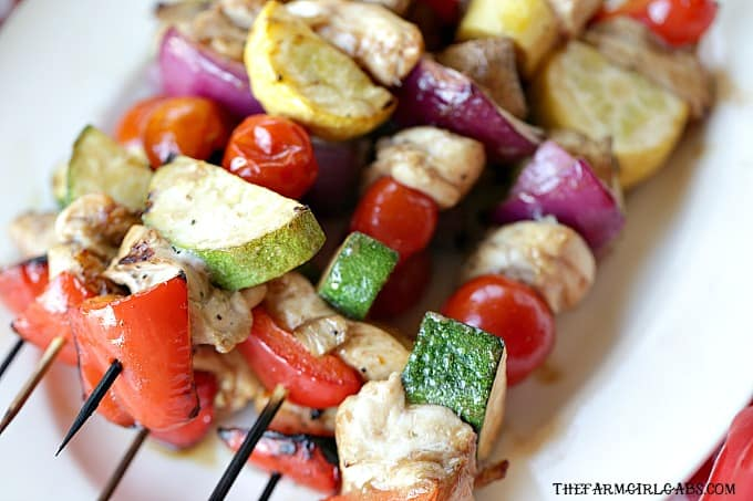 This Italian Herb Chicken Skewers recipe is easy to make and sure to please. Get your grill on and try this tasty recipe. #chickenrecipe #grilling #chickenskewers #kabobs #grilledchicken