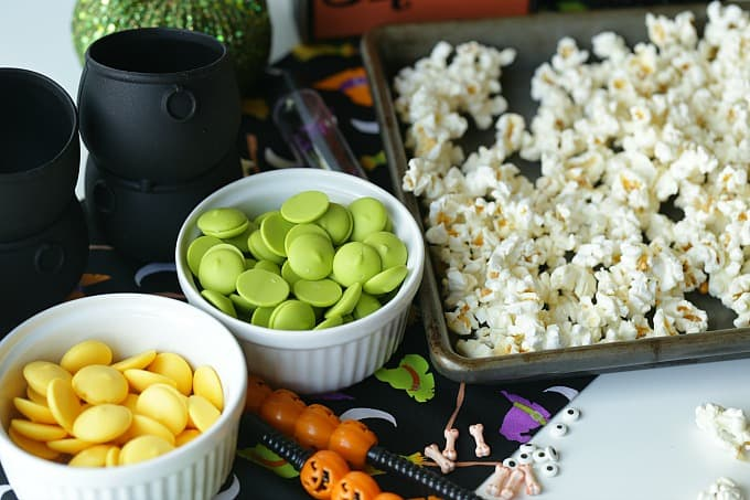 Double, double toil and trouble, Fire burn, and cauldron bubble. Stir up a batch of this ghoulishCauldron Corn for some Halloween fun. #Halloween #Halloweenparty #HalloweenCandy #Snacks #Popcorn