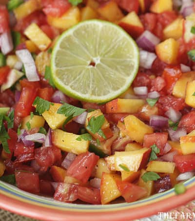 Spice up your summer with this tasty Peach Pico de Gallo recipe. Grab those fresh farmers market peaches and whip up a bowl to snack on. #Peach #PicodeGallo #Salsa #PeachRecipe #Appetizer #Dips #DipRecipe #Farmersmarket