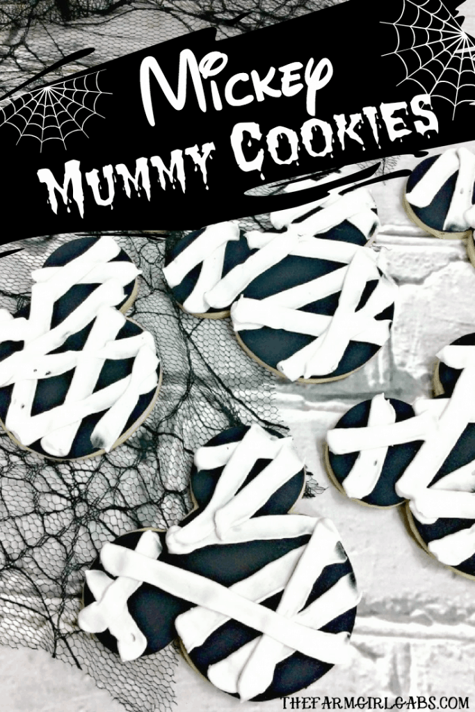 These hauntingly adorable Mickey Mummy Cookies are the perfect Disney Halloween Treat. Make a batch for family and friends to share this Halloween. #Halloween #Cookies #SugarCookies #MickeyMouse #DisneyHalloween #WaltDisneyWorld #Pumpkin