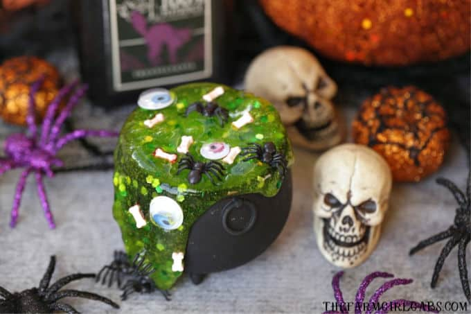 The Sanderson Sisters are at it again. A special mixture of Hocus Pocus, bat wings and bones makes up this spooky Halloween Cauldron Slime. #Slime #SlimeRecipe #Halloween #HalloweenCraft #KidsCraft