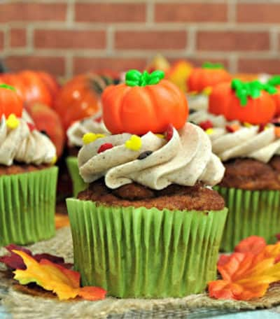 Pumpkin Spice Cupcakes are the perfect way to celebrate the fall season. They are full of pumpkin spice and topped with a sweet cinnamon buttercream frosting. #pumpkinspicecupcakes #pumpkinrecipe #fallbaking #pumpkindessert #cupcakes