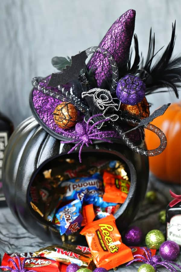 This adorably spellbinding Witch Pumpkin Candy Holder is the perfect place to store your Halloween Candy Stash.
