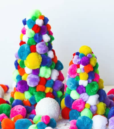 You can never have enough Christmas trees during the holiday. Add a bit of fun to your holiday decor and make a few of these DIY Pom Pom Christmas Trees. #PomPomTree @PomPomCraft #ChristmasDecoration #Christmas #PomPomChristmasTree