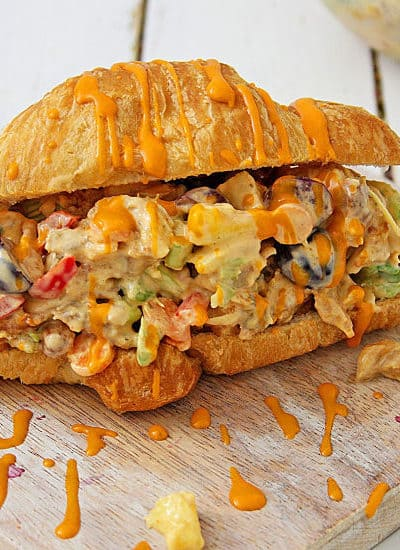 This buffalo chicken salad sandwich is so tasty! Packed with chicken fruit and veggies, It's the perfect sweet and spicy sandwich recipe for lunch or dinner.