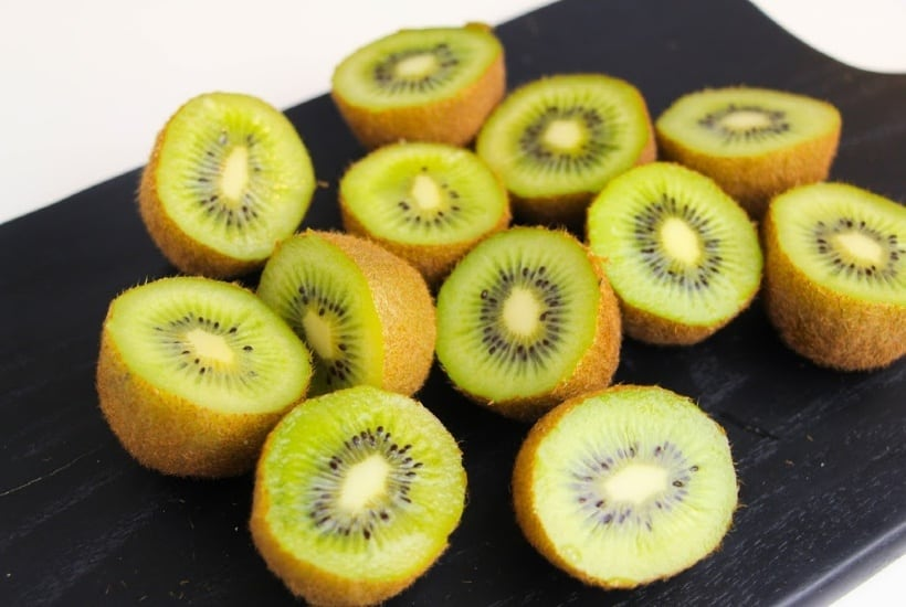 This easy Kiwi Fruit Salad With Honey Citrus Dressing recipe is perfect to enjoy any time of the year. The optional honey citrus dressing adds the perfect amount of sweetness. #fruitsalad #kiwi #mandarinorange #dessert #healthyrecipe