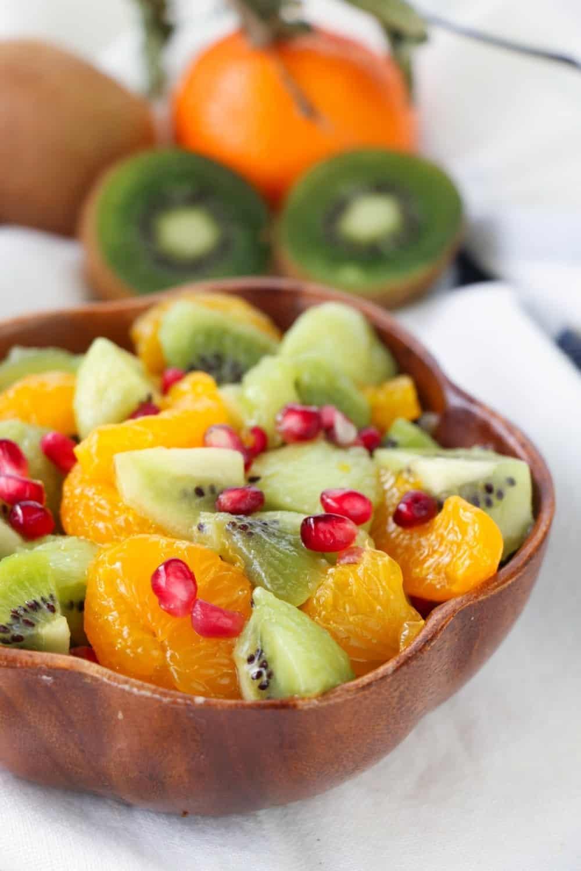 This easy Kiwi Fruit Salad With Honey Citrus Dressing recipe is perfect to enjoy any time of the year. The optional honey citrus dressing adds the perfect amount of sweetness. #fruitsalad #kiwi #mandarinorange #dessert #healthyrecipe