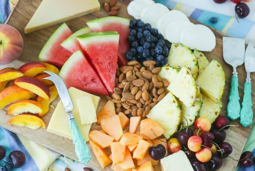 Take summer entertaining to the next level with this easy Summer Fruit And Cheese Board. This fruit and cheese board is an easy party recipe. Your guests will love this Charcuterie board made with fresh summer fruits, cheeses and Blue Diamond Almonds. #ad #WholeNaturalAlmonds, #SimplyDelicious #cheeseboard