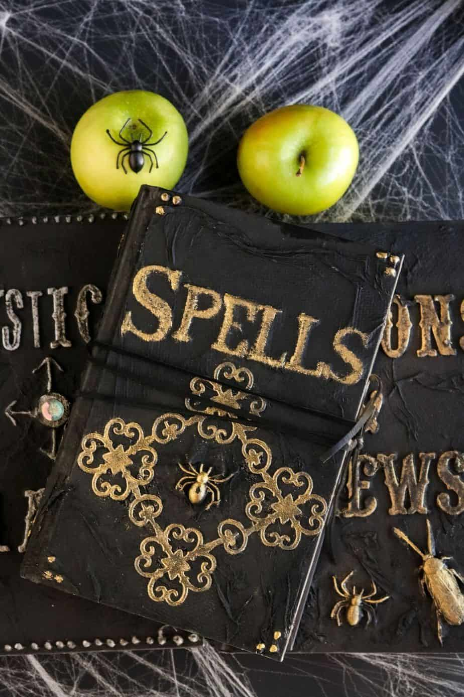 Cast a spell on your friends and family this Halloween. Create your own Halloween Spell Book with this easy craft tutorial. This Halloween craft is spellbinding! #halloweencraft #hocuspocus #halloweendecor