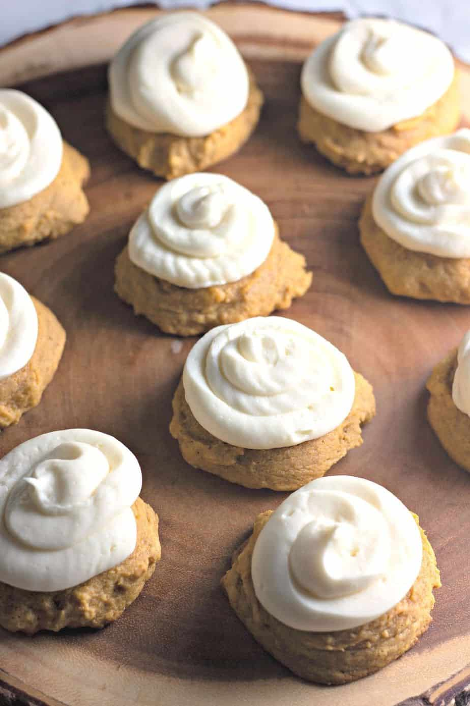 These Bakery Style Soft Pumpkin Cookies are soft and mildly sweet with just the right amount of pumpkin spice. The cream cheese icing is the perfect topping make this pumpkin cookie recipe a perfect fall treat. #pumpkincookies #pumpkinrecipe #falldessert #cookierecipe