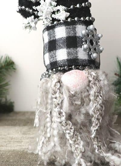 Gnomes are so popular right now. Celebrate the season with this DIY Buffalo Check Christmas Gnome is a fun Christmas craft you can make yourself.
