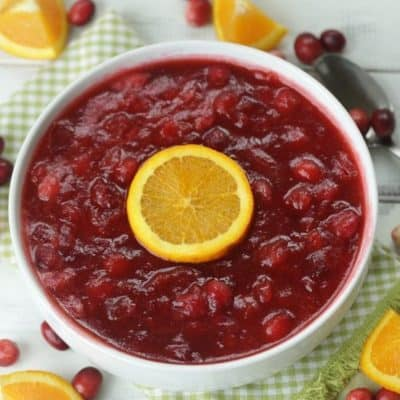 Orange Amaretto Cranberry Sauce is the perfect Thanksgiving dinner side dish. Tart cranberries, sweet orange and amaretto team up for this delicious fall recipe. This easy cranberry sauce recipe is a family favorite. It's not Thanksgiving without this delicious cranberry sauce. #cranberrysauce #orangeamarettocranberrysauce #thanksgivingsidedish