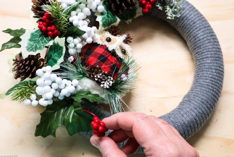 Add a rustic farmhouse touch to your Christmas decor this year. This whimsical DIY Woodland Owl Christmas Wreath is an easy Christmas craft project. #christmaswreath #christmascraft