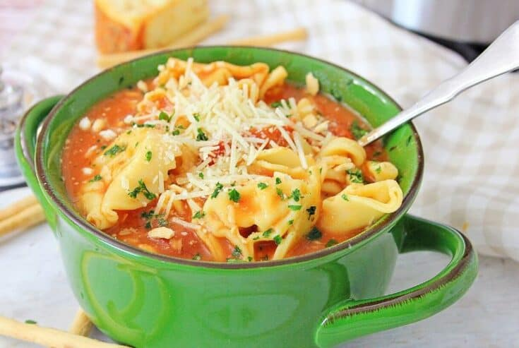 Warm yourself up with a bowl of this Instant Pot Chicken Parmesan Soup. This easy instant pot soup is a delicious comfort food recipe. This easy Chicken Parm soup recipe will be a family favorite.