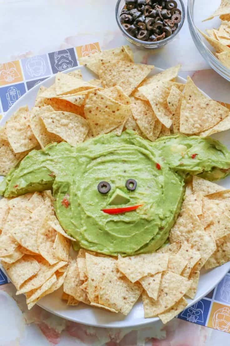 Whether it's Cinco de Mayo or Star Wars day, this Baby Yoda Guacamole Platter is the fun entertaining recipe that Star Wars fans will think is out of this world.Everyone loves an easy guacamole recipe and this one is perfect for the Baby Yoda fans in your life.