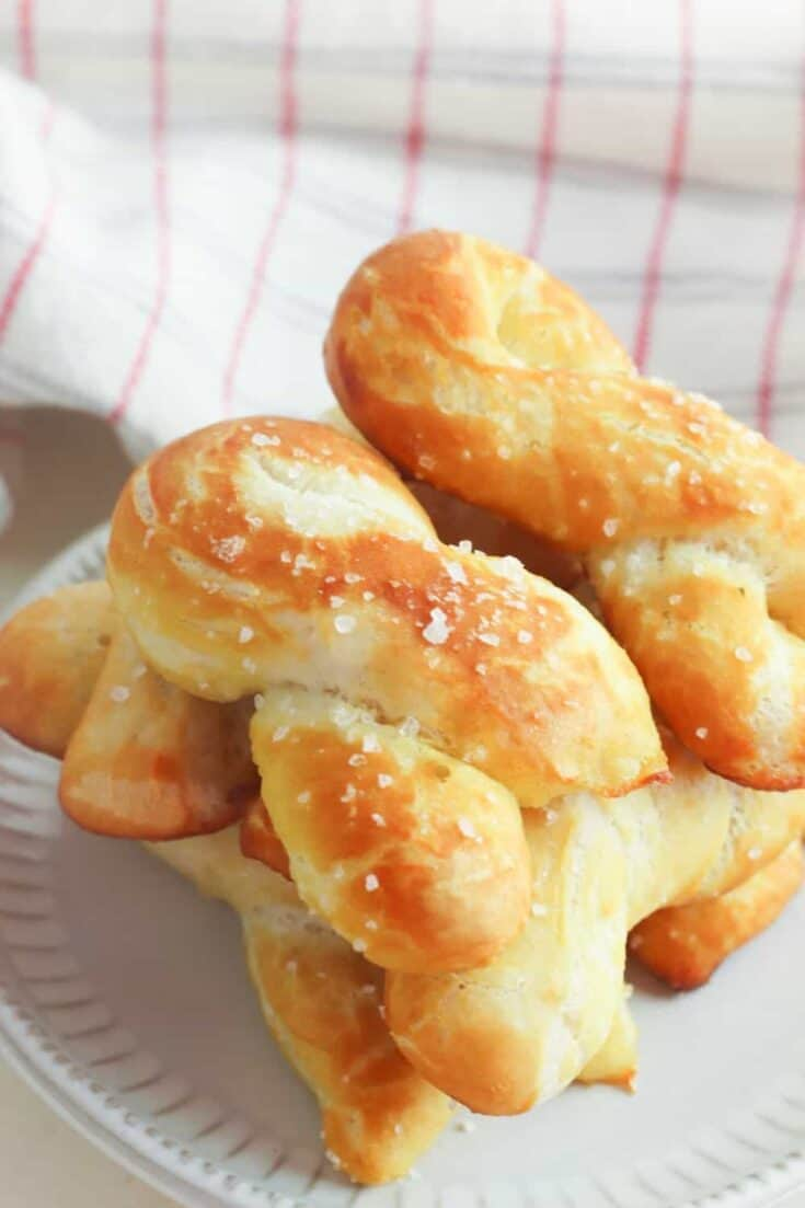 Craving a salty snack? Whip up a batch of these Easy Homemade Soft Pretzel Twists. This easy snack recipe won't last long. This basic pretzel dough recipe can be shaped into twists, knots, bites or the classic pretzel shape.