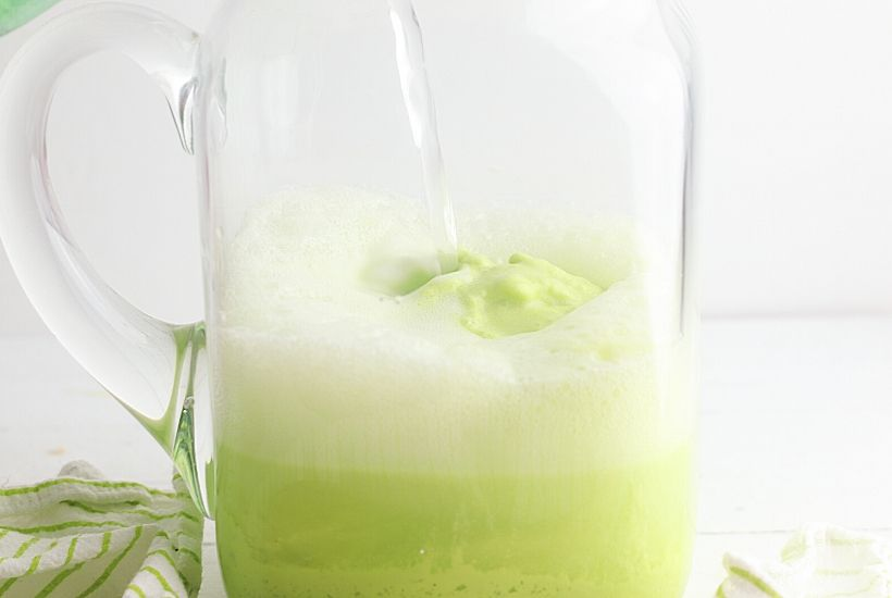 Cool off with a glass of this refreshing Frozen Limeade Punch. This is an easy frozen drink recipe that makes a great party punch too. This non-alcoholic drink recipe is the perfect mocktail for kids and adults. It is a big batch recipe so it is a perfect party drink. This limeade slushie recipe is a winner.
