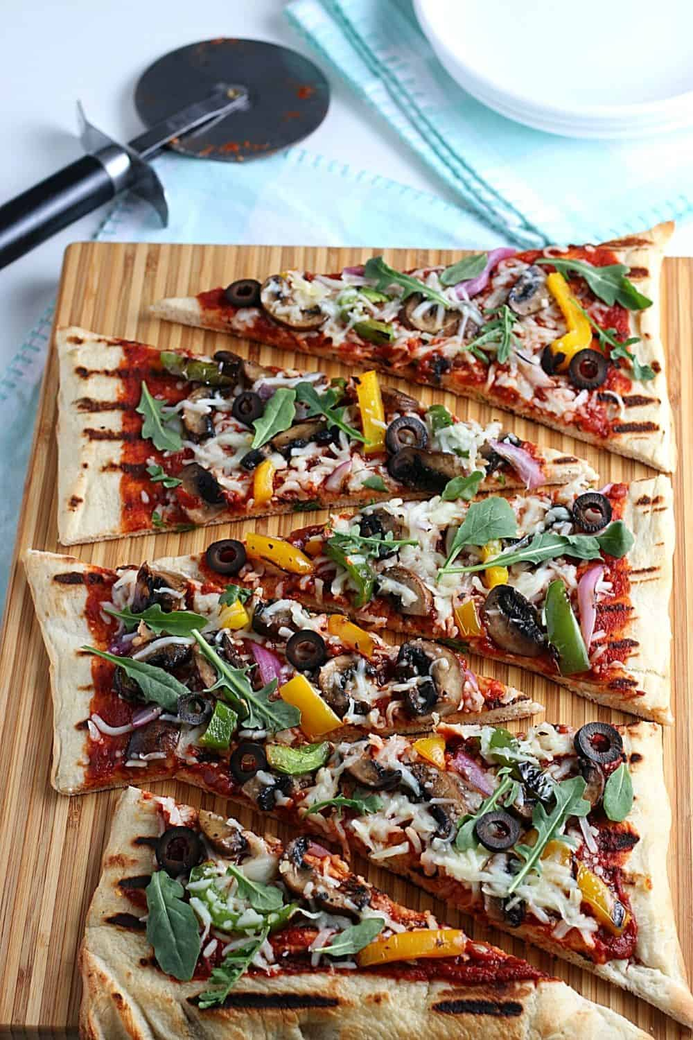 It's time to fire up the grill and turn a traditional pizza recipe into an easy and delicious Grilled Pizza. Here's How To Make the Perfect Grilled Pizza recipe.