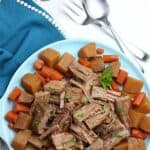 Bring the taste of comfort food home with this classic Crock Pot Beef Roast recipe. The hearty meal cooks at a steady pace in the slow cooker to provide a meal that will melt in your mouth. This easy slow cooker pot roast recipe is loaded with carrots, potatoes and onions. No need to turn the oven on with the easy Crock Pot Pot Roast recipe.
