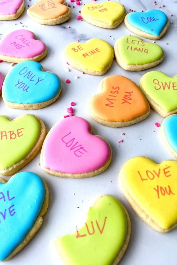 "Easy Sugar Cookies With Royal Icing Take your favorite conversation hearts Valentine candy and turn them into these fun Conversation Heart Sugar Cookies. This Valentine's Day Sugar Cookie recipe is ""rly sweet""."