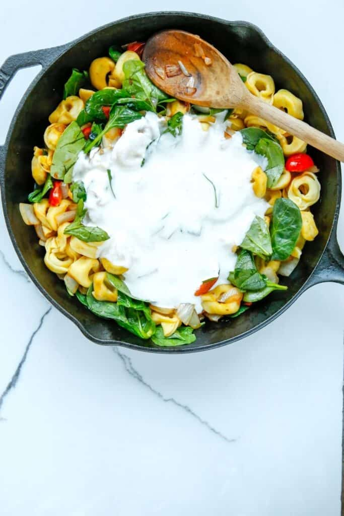 Enjoy the fresh taste of tortellini, shredded cheese, baby spinach, and tomatoes mixed to create this tasty and fulfilling Creamy Tortellini Pasta Skillet