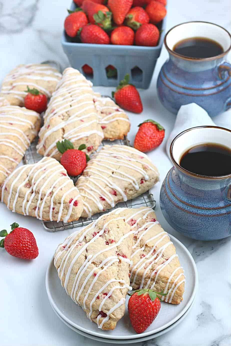 Impress your family with homemade baked goods that they can have for breakfast or a snack. This Strawberry Scones recipe is fun to make and will stay fresh for several days. These fresh-baked scones are soft, flaky and bursting with juicy strawberries! This is also a great freezer friendly recipe. Bake a batch of these fresh strawberry scones and freeze to enjoy at a later time.