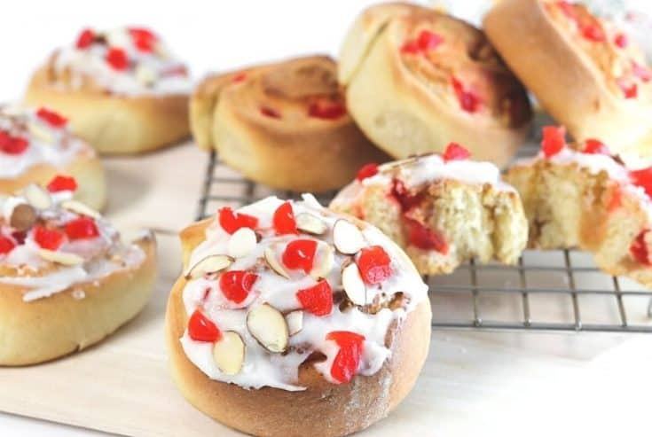 If you love eating baked goods for breakfast, try this Swedish Breakfast Rolls Recipe. These rolls are sweet, soft, fluffy, and perfect to eat for a quick grab and go breakfast. This easy Swedish breakfast bun recipe is consists of a sweet dough flavored with cardamon. Almonds and cherries are added and the sweet rolls are topped with a delicious icing glaze.