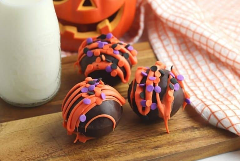 Fall is in the air and that calls for a warm treat. These Halloween Hot Cocoa Bombs are a perfect way to celebrate fall. Hot cocoa bombs for fall are filled with hot chocolate mix, miniature marshmallows and are nestled inside a delicious chocolate shell.