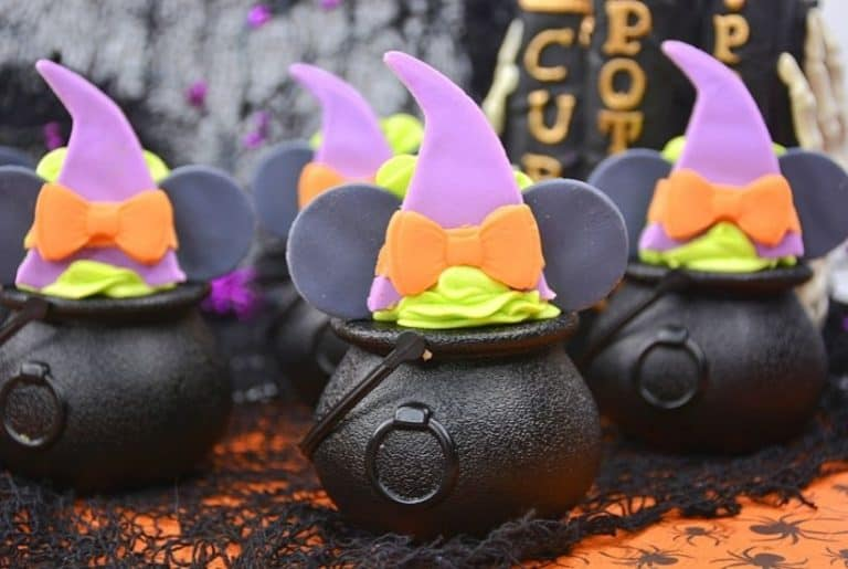These bewitching Minnie Mouse Cauldron Cakes are a fun Halloween cupcake recipe to serve. You'll love this easy Halloween treat recipe. Disney fans will love making this easy cupcake recipe to celebrate Halloween and Disney. Minnie Mouse dressed in her best witch hat adorns the top of these mini-cauldron cakes. It's a fun Disney Halloween treat for kids or to make for a Halloween Party.